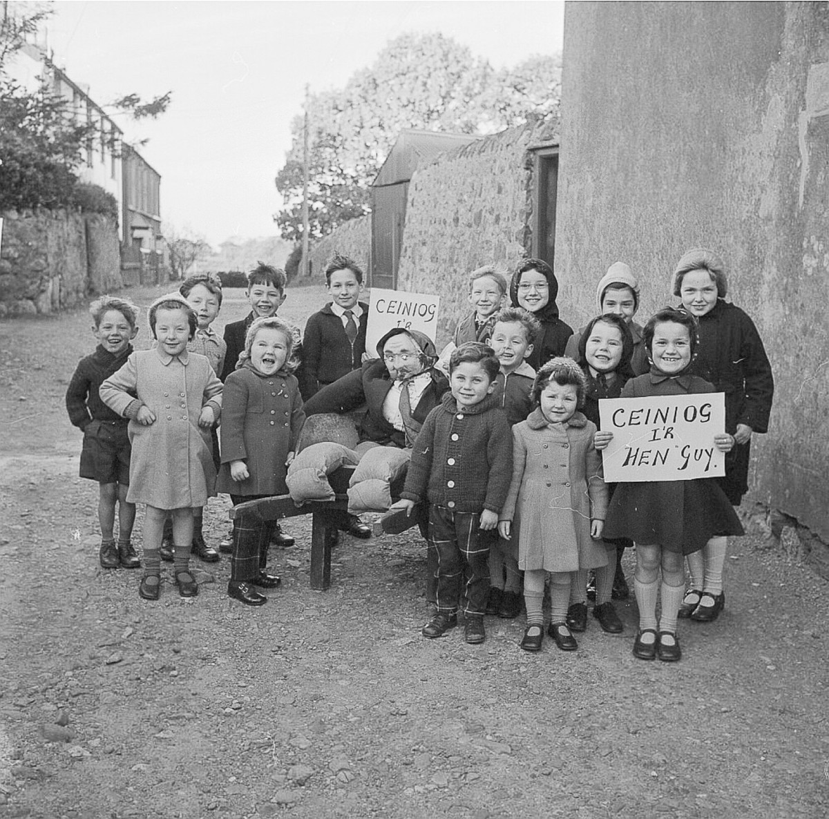 Children in Wales ask for a penny for the guy in 1962.