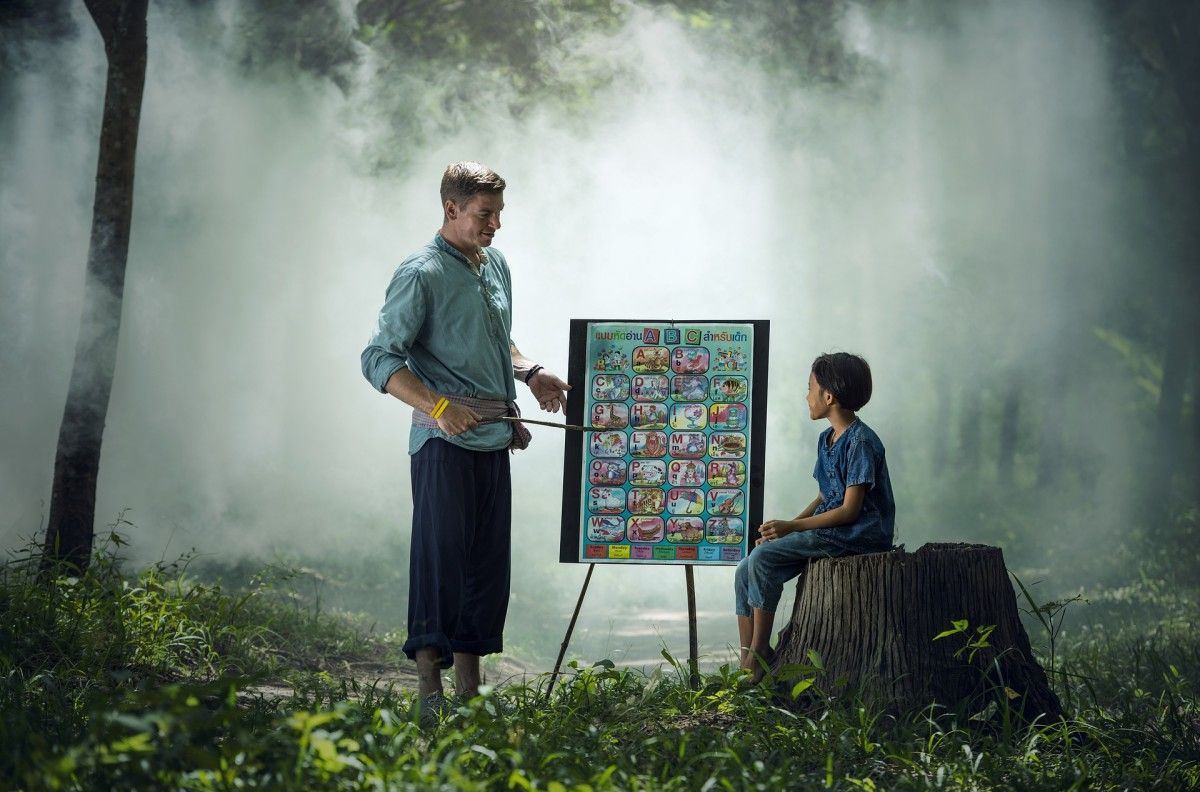 I don't know why this teacher is teaching his student outside in a foggy forest. District budget cuts, perhaps?