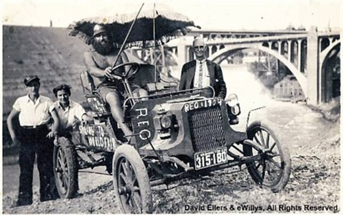 This is a photograph of Willis Ray (Willie) Willey in the 1904 Reo that he drove to the World's Fair in Chicago in 1933, encountering police all along the way and arrested many times.