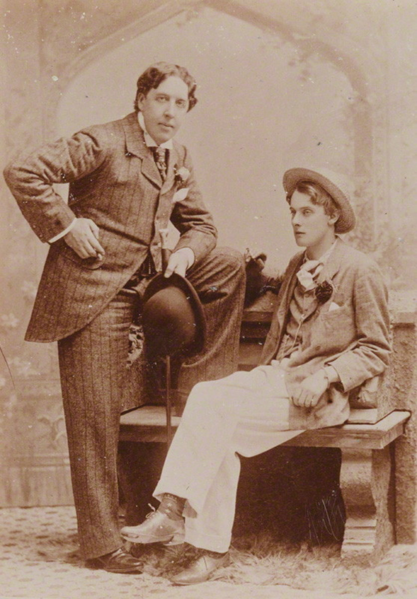 Oscar Wilde (standing) with Lord Alfred Douglas.