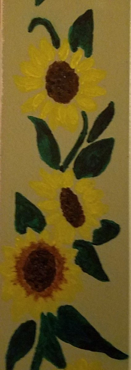 Sunflower mural that this hub's author painted on a wall of her home in 2013.