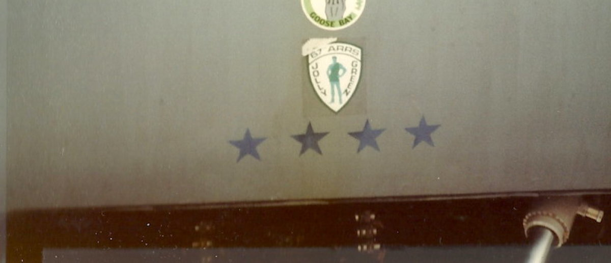 An RAF Vulcan bomber, circa 1983.  The 4 stars signify this aircraft flew a four star general,  The top emblem, if shown in full, is an obscene gesture.