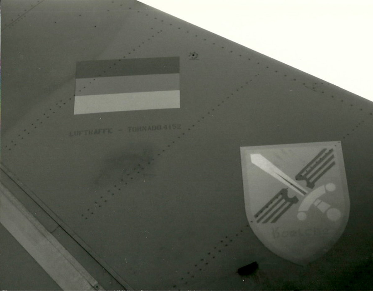 The tail of a Luftwaffe Tornado.  It has its national roundel and it's unit emblem.