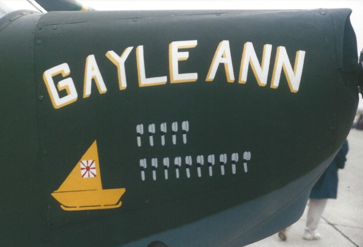 "A Commemorative Air Force Stinson L-5 Sentinel with the markings of ""Gayle Ann"".  The original Gayle Ann sank a Japanese boat with submachine gunfire and grenades.  The other symbols represent Forward Air Control missions flown."