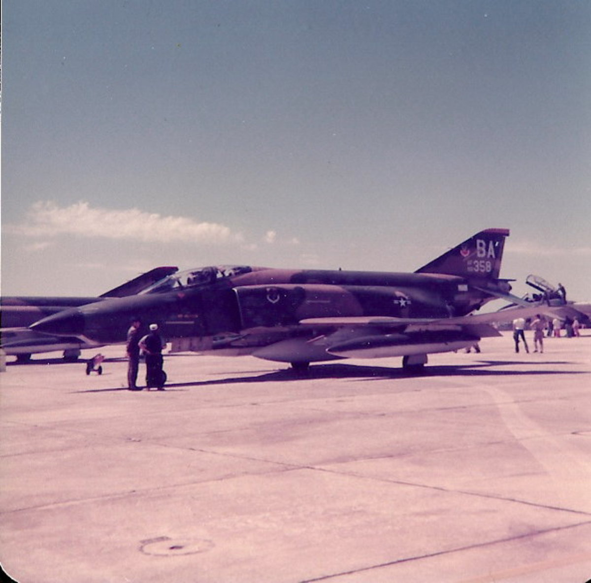 A USAFF-4 Phantom II with camouflaged paint scheme and subdued USAF roundel.