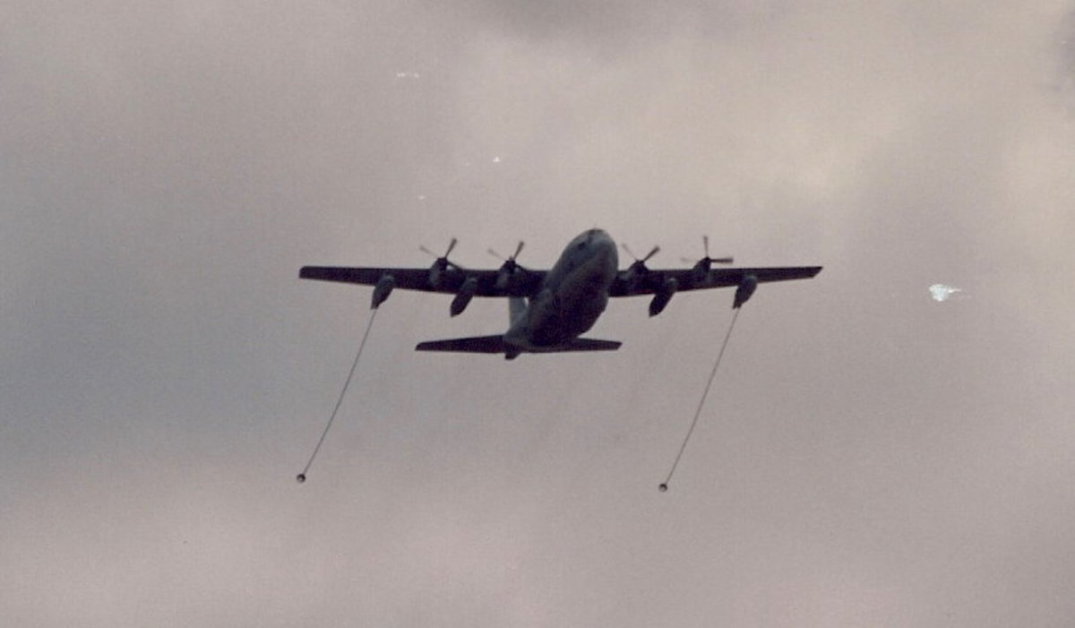 A USMC KC-130 with its refueling drogues out.  Washington, DC, June 1991.  During the Desert Storm victory parade.