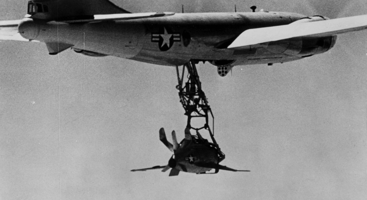 A XF-85 Goblin attached to its mother ship, an EB-29.