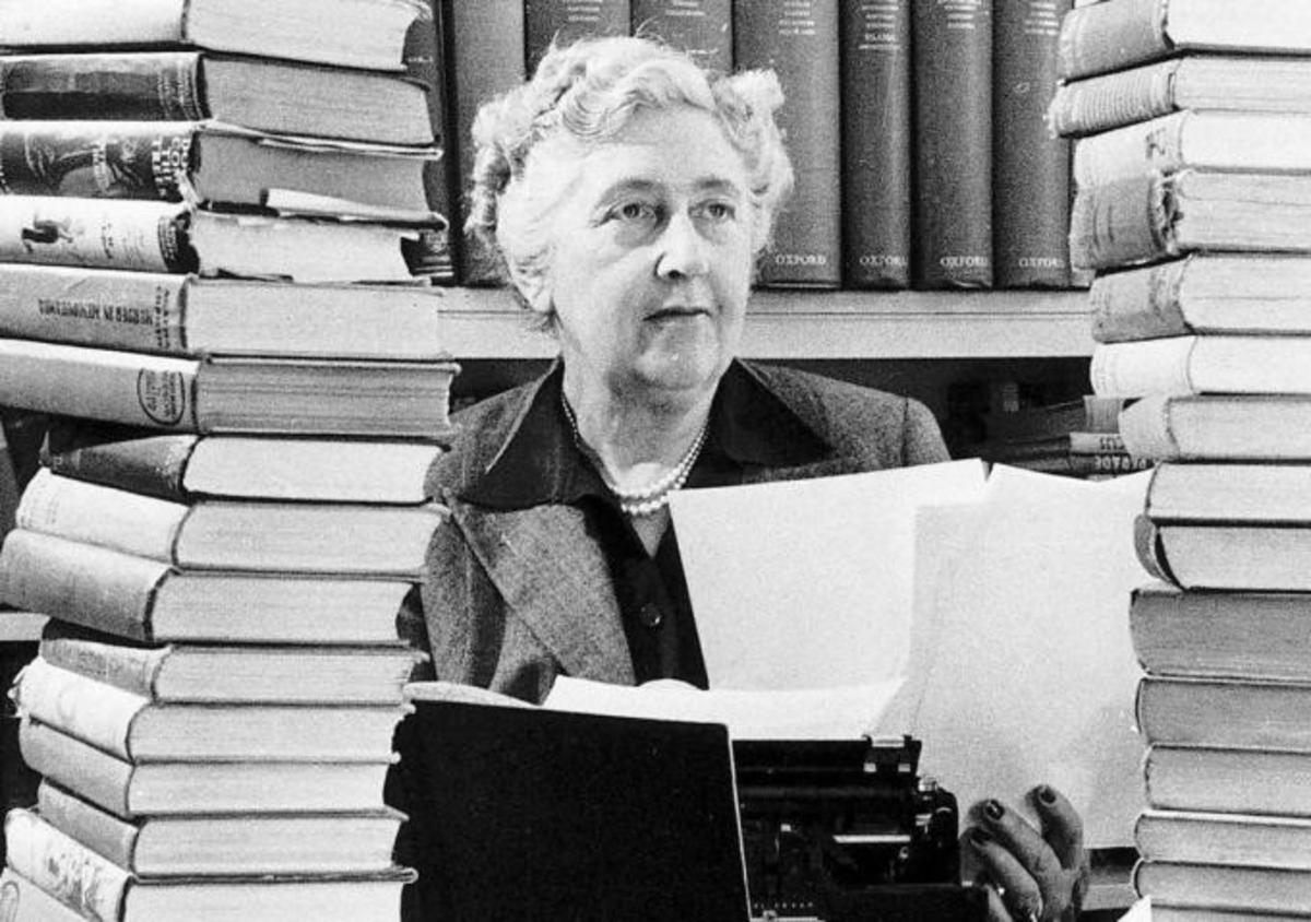Agatha Christie surrounded by some of the many books she wrote