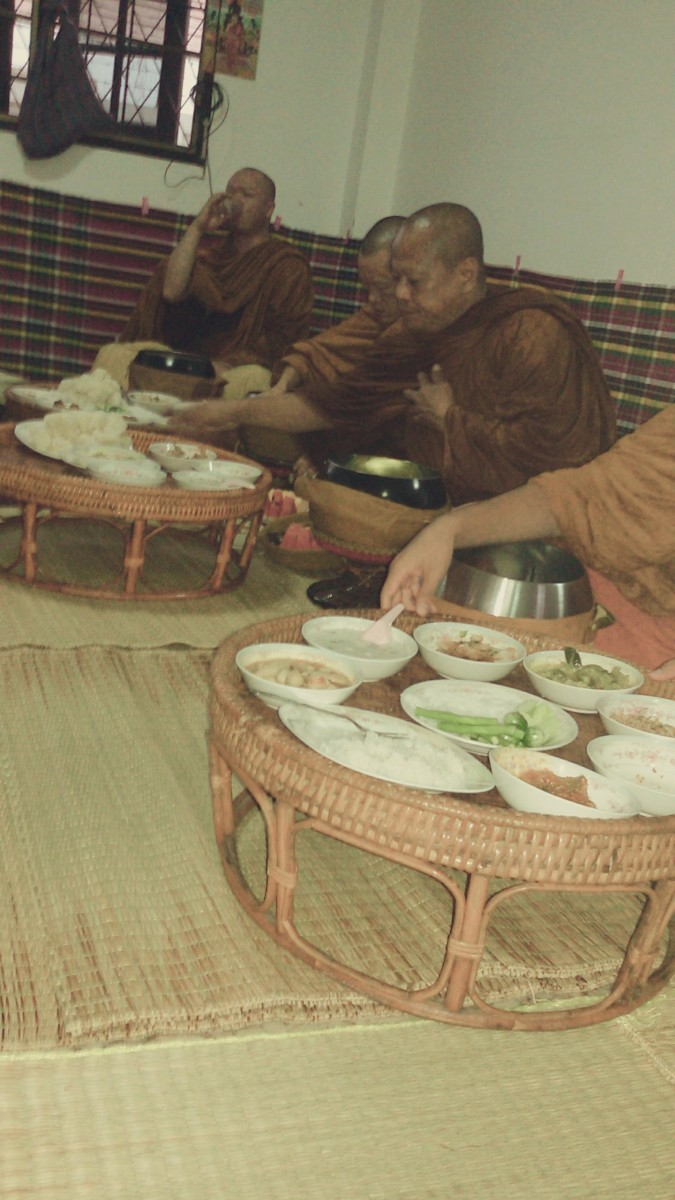 Monks Partaking of Food Offerings