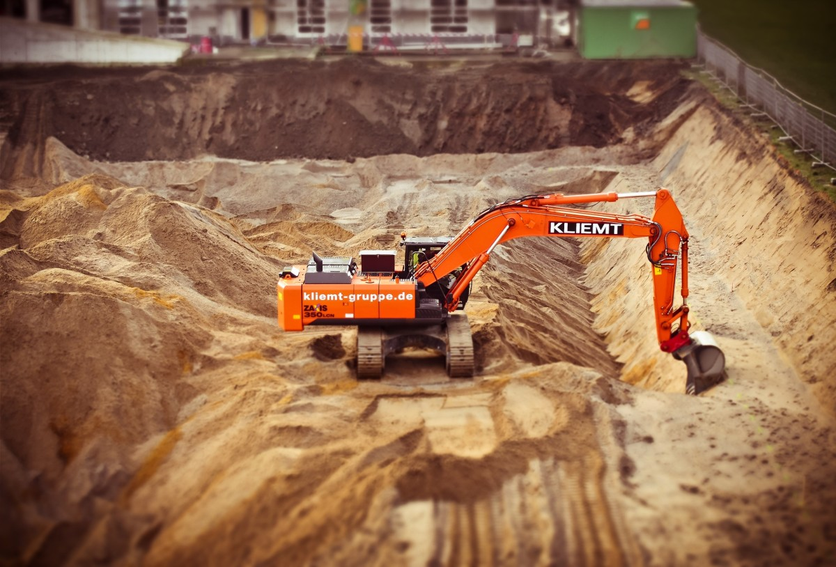 Soil replacement means excavating the poor soil, disposing of it, and bringing in new soil to establish a strong base for a foundation.