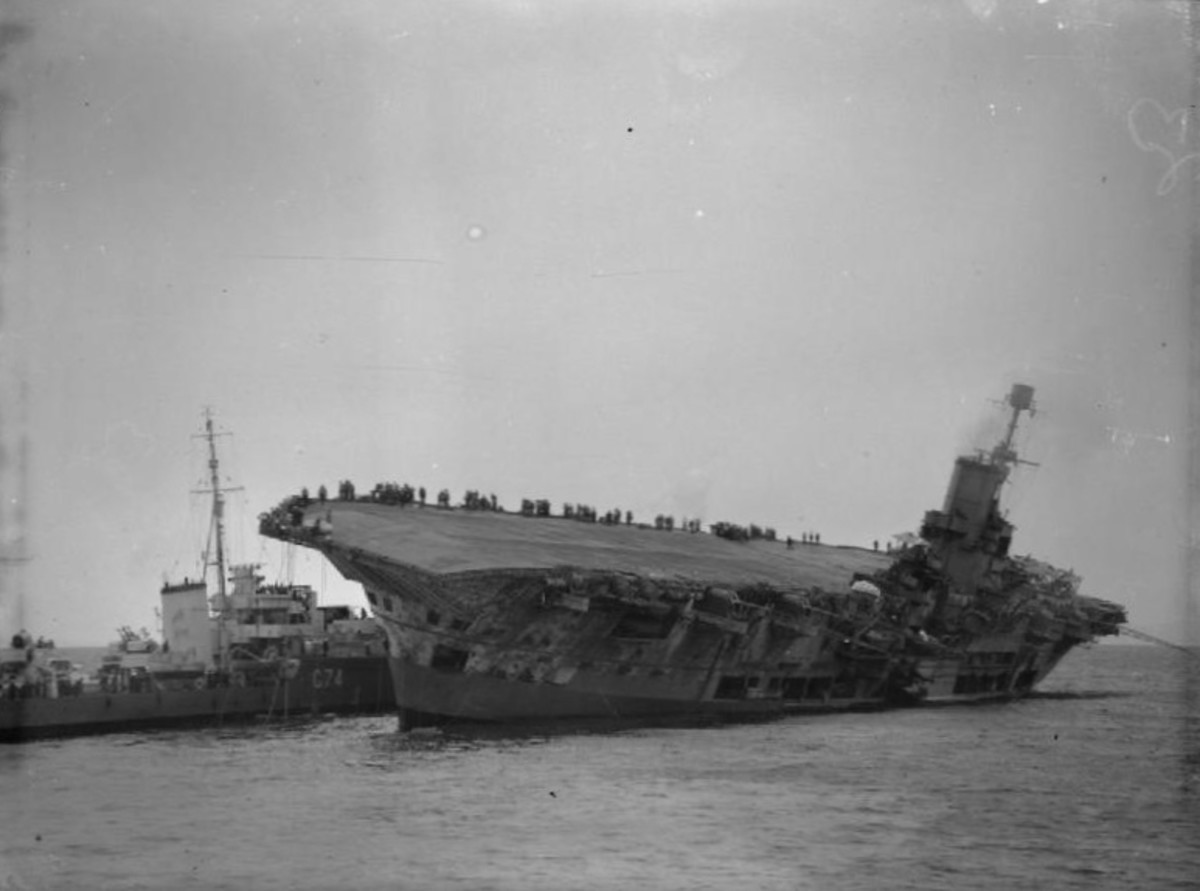 The crew and Sam are rescued from the badly listing HMS Ark Royal.