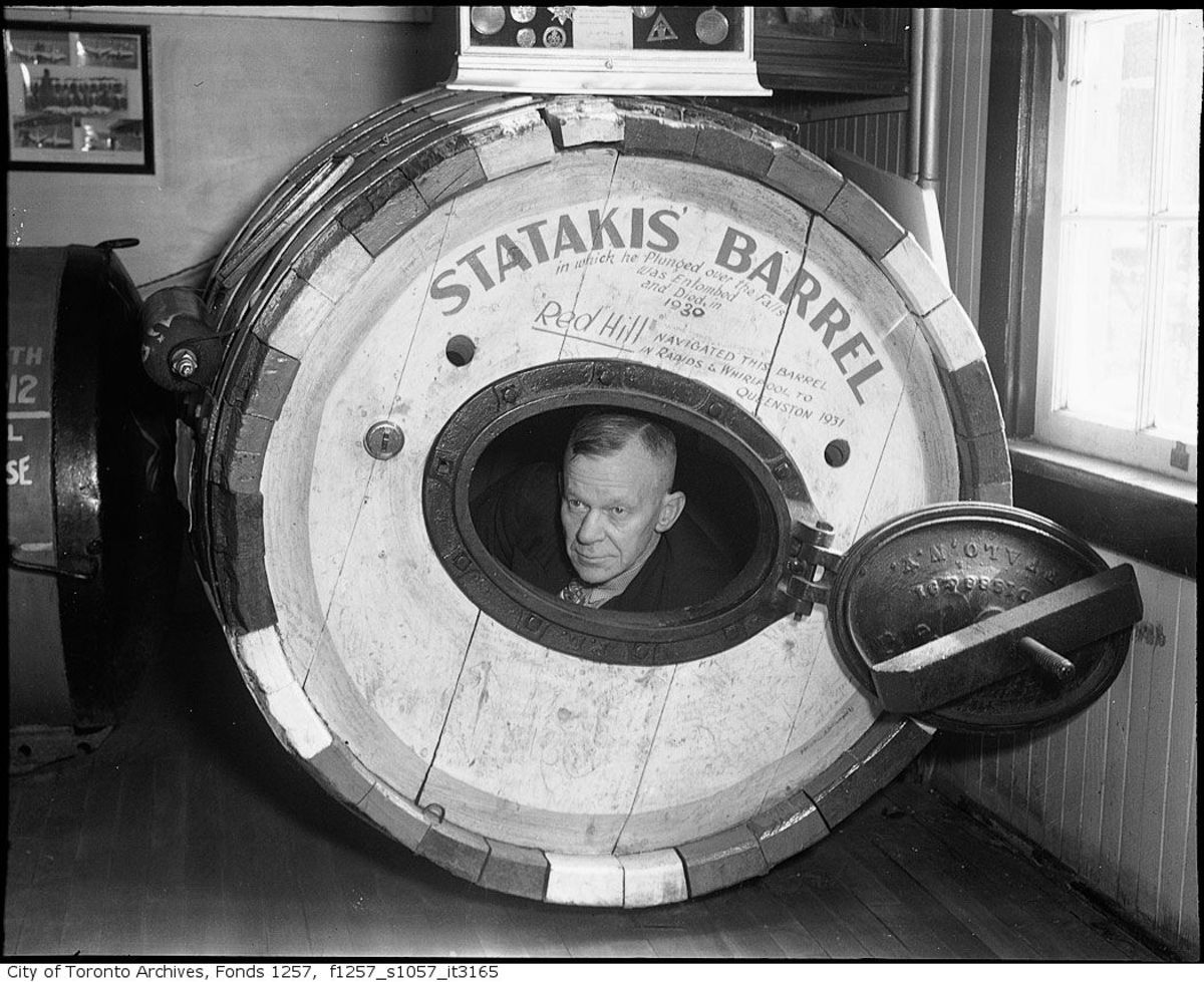 """Red"" Hill was a famed Niagara waterman and adviser to several barrel jumpers. Here he peeks out from George Statakis barrel, which he recovered from the river."