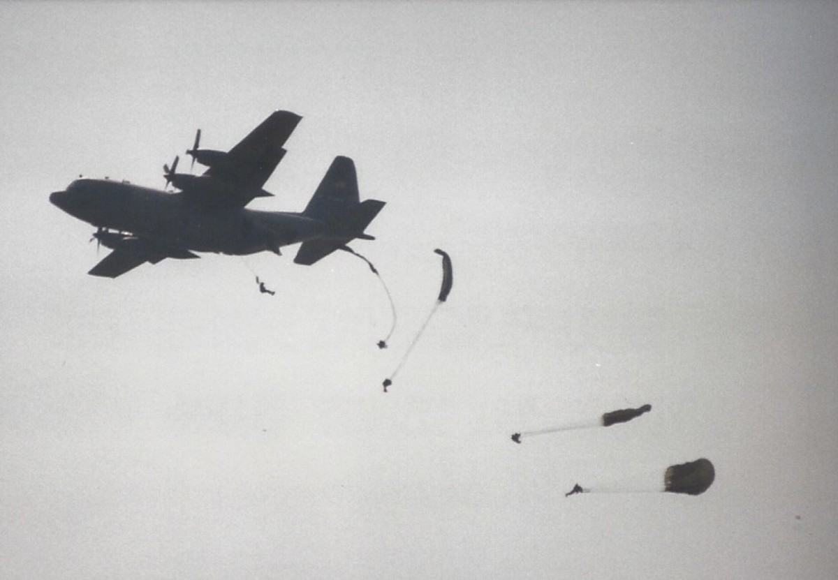 Paratroopers of the 82nd Airborne Division jumping from a C-130 over Andrews AFB, MD.