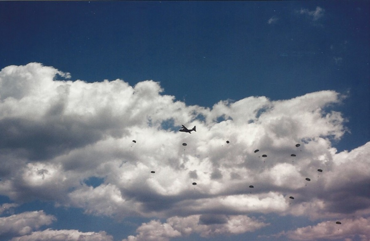 A C-130 during a mass parachute jump at Andrews AFB, MD
