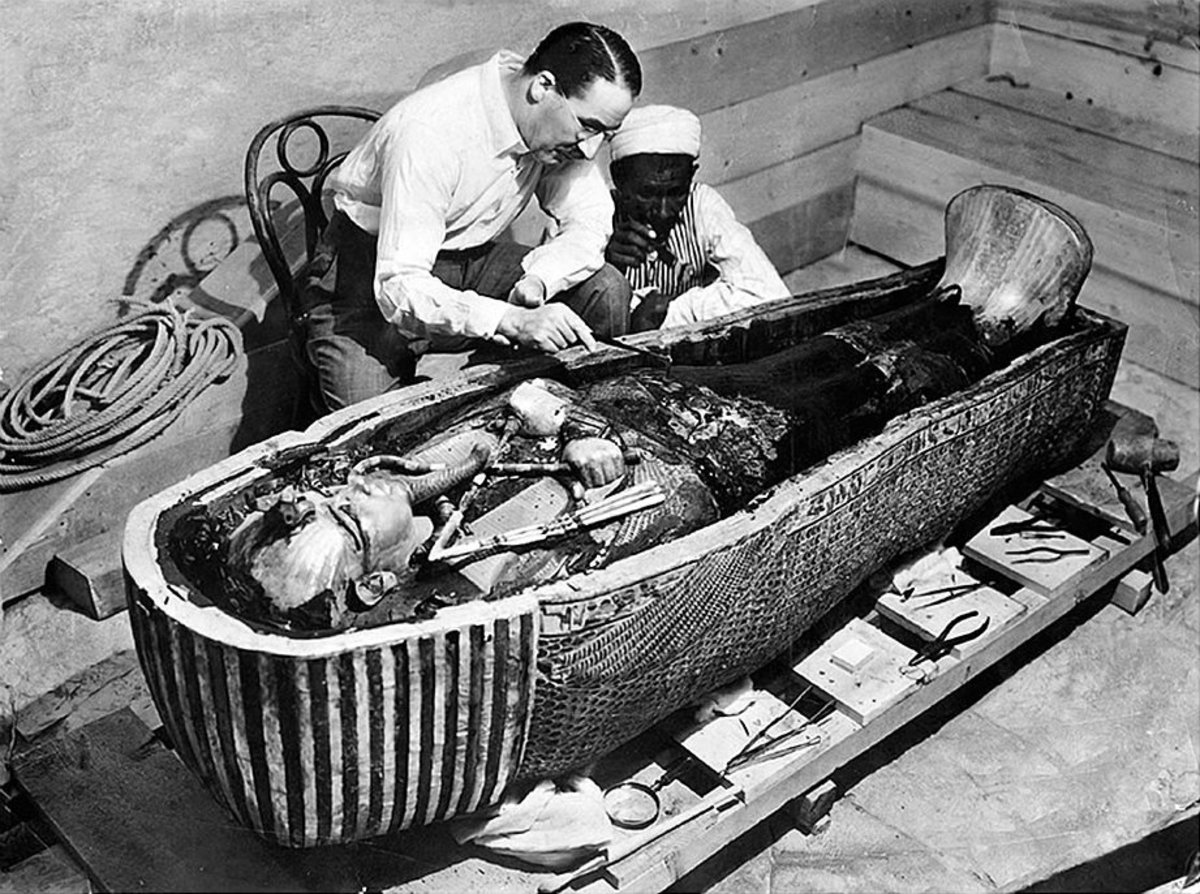 Howard Carter opens the innermost shrine of King Tutankhamun's tomb near Luxor, Egypt which one of carter's water boy found the steps down to.