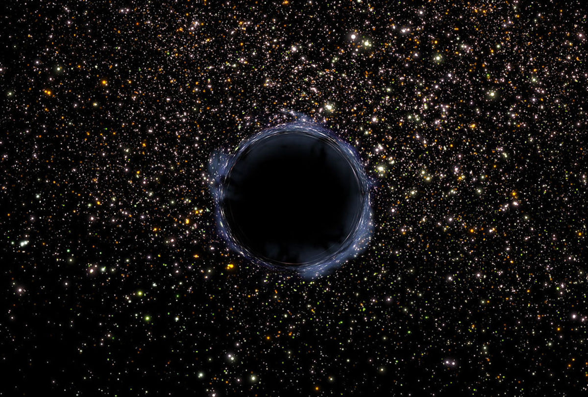 A NASA image of a black hole in the universe. A black hole is an area of infinite density which draws matter and energy into itself