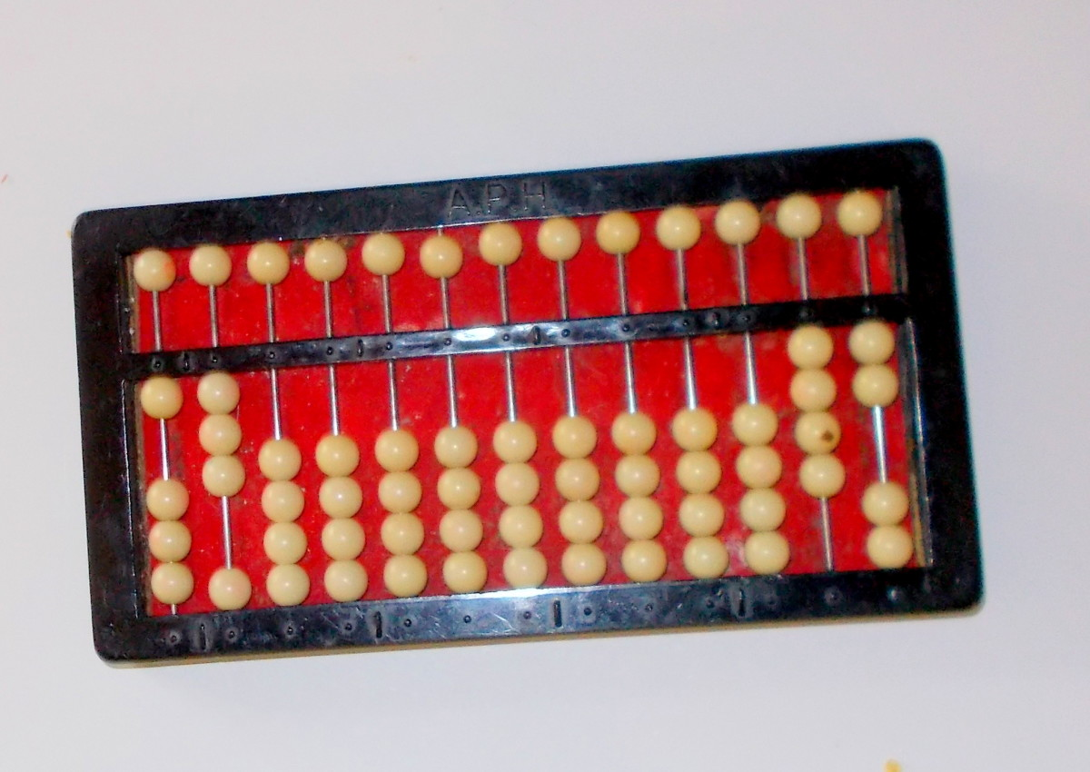 This abacus is showing the fraction one-half multiplied by the fraction ¾.