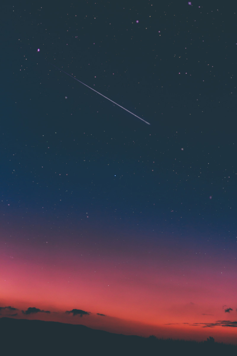 "A photograph of a ""shooting star"". Shooting stars are actually particles of space debris, ice and rock, burning up as they enter the earth's atmosphere"