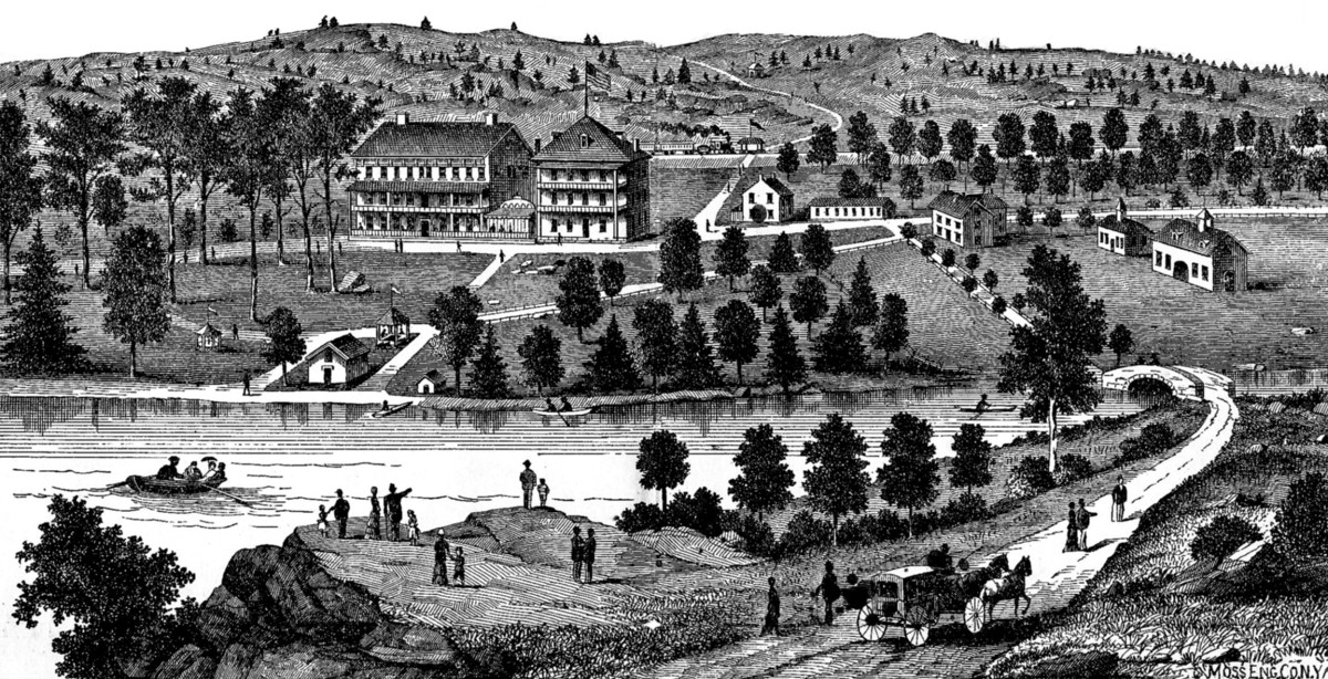 The Cold Spring Resort in its heyday. What was then a cleared-out mountain side with a lake now looks much different as the buildings and lake are gone, and the slopes and valley are once again covered with thick forest.