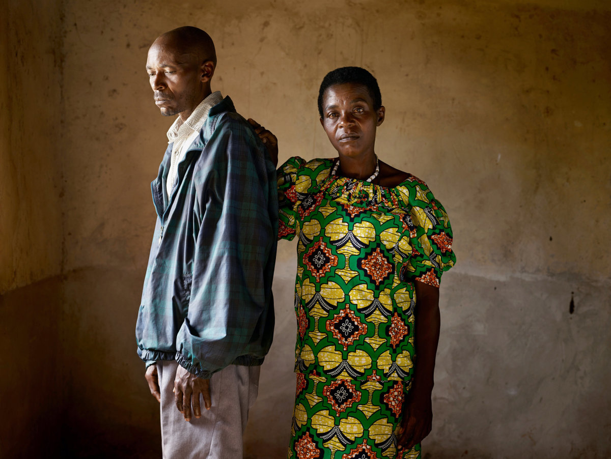 Jean Pierre Karenzi, a perpetrator (left) and Viviane Nyiramana, a survivor (right) pose for photographer Pieter Hugo after the genocide