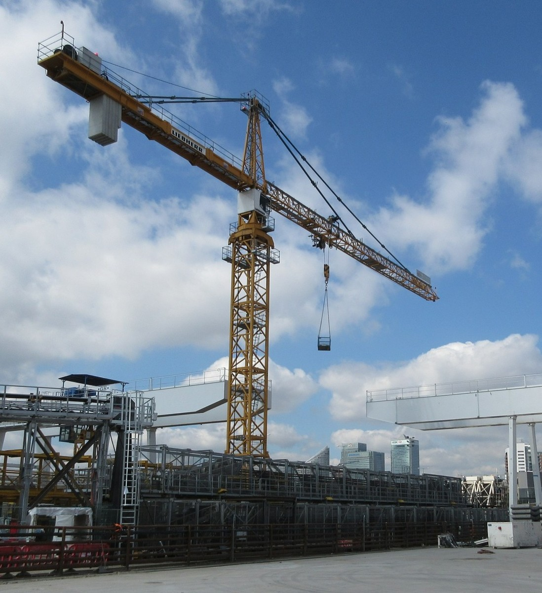 A tower crane. The counterbalance consists of a collection of concrete slabs mounted near the end of the boom.