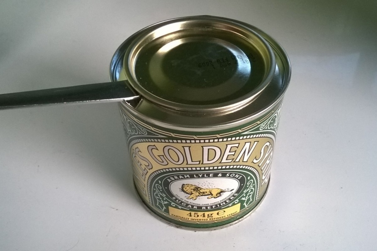 Using the handle of a spoon to open a tin. The spoon acts as a lever, creating a larger force to lift the lid. The fulcrum is the rim of the tin