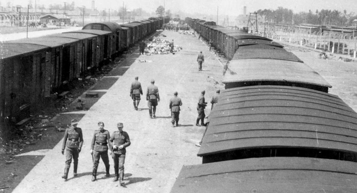 Unloading area, Auschwitz - the crematoria smokestacks are visible in the distance.