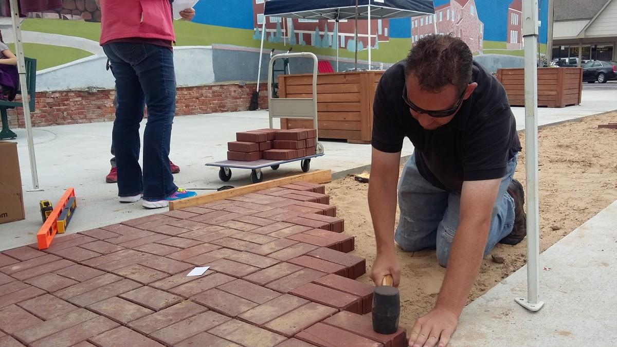 Eric Standridge laying brick