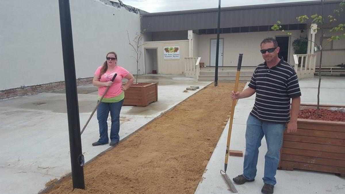Julie Jenkins and Eric Standridge laying the sand base