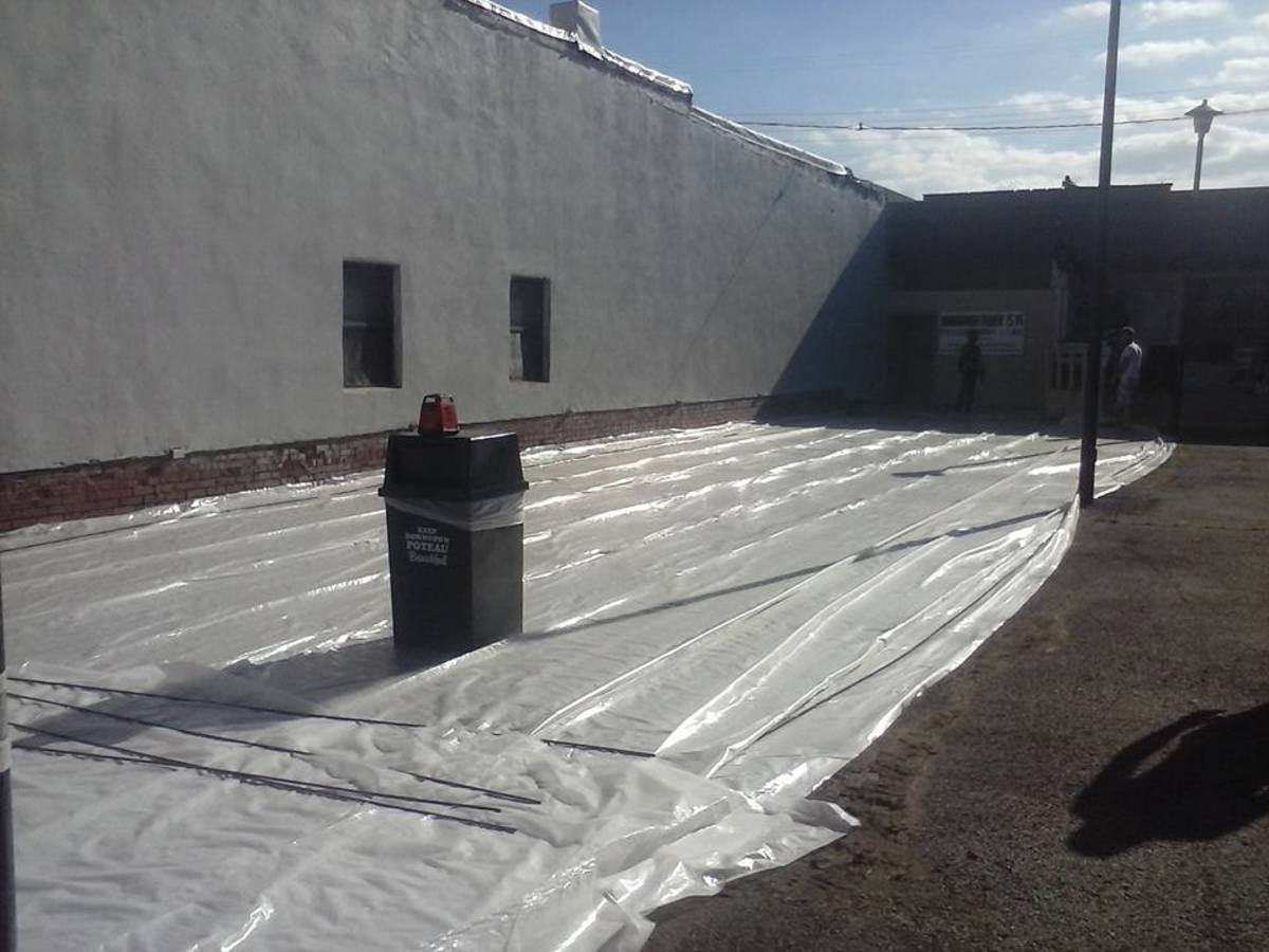 Laying the initial vapor barrier