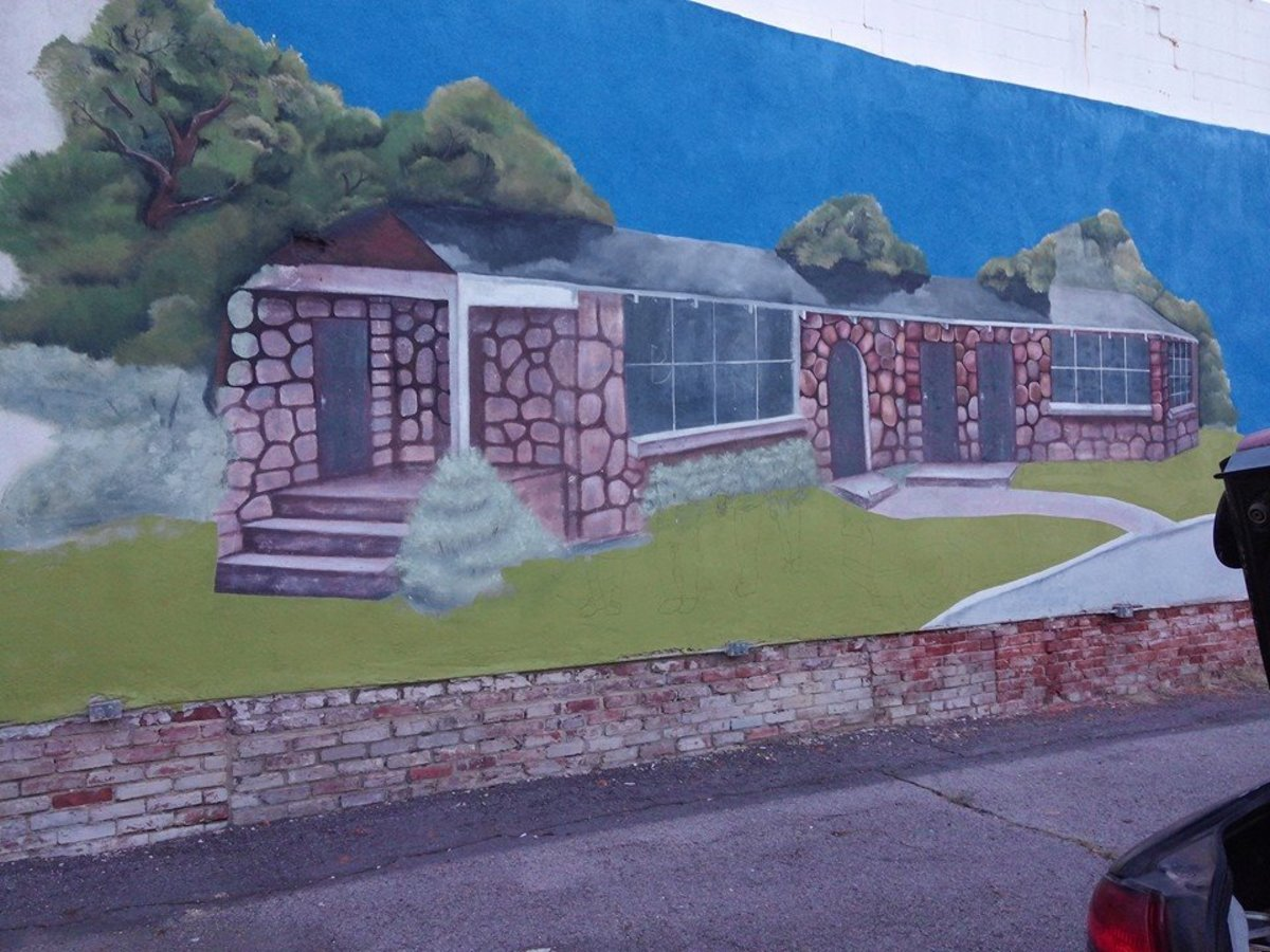 Existing 1992 mural repainted and cleaned up.