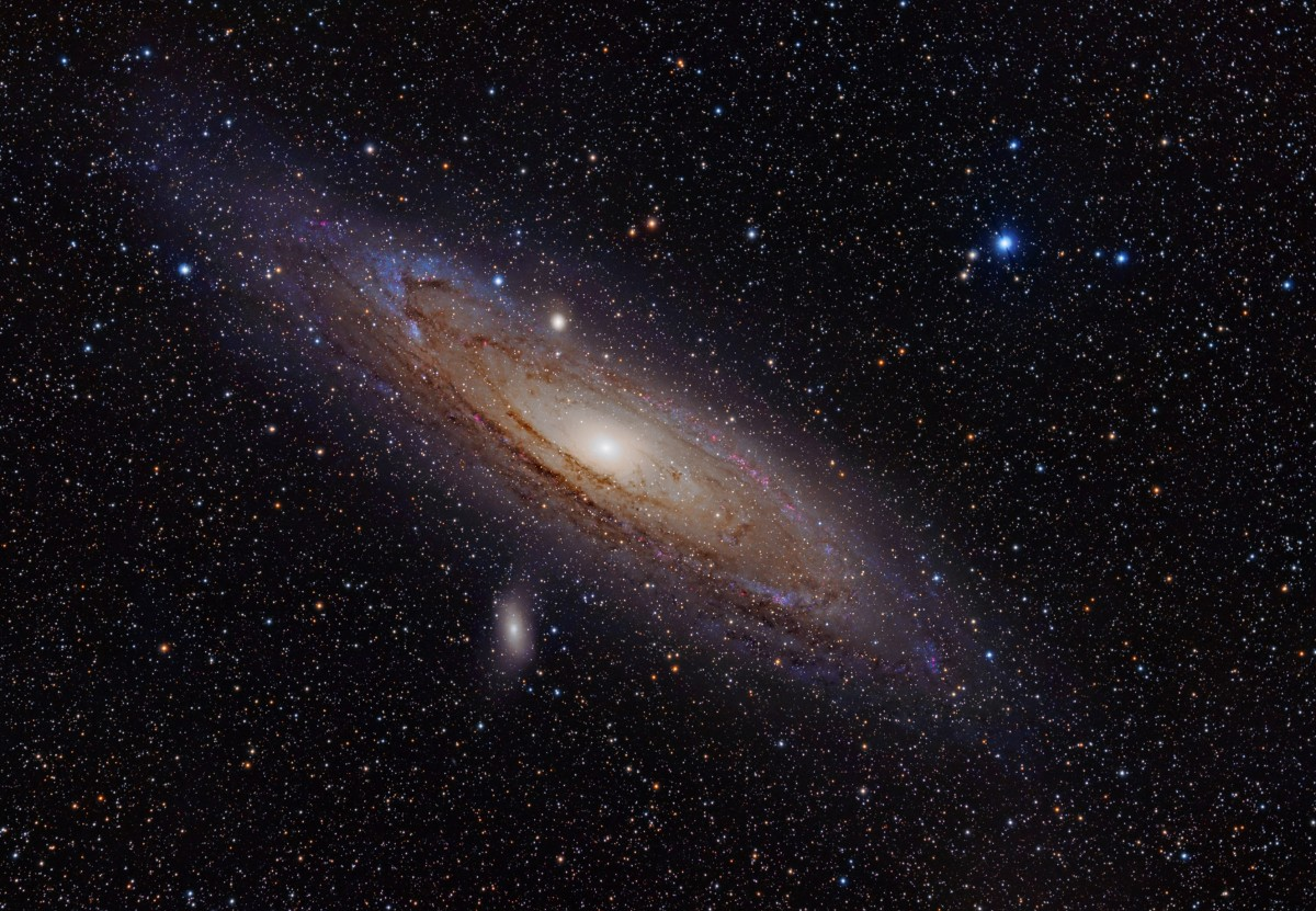 We live in the Milky Way galaxy. The Andromeda Galaxy is the nearest galaxy to Earth at about 2.5 million light years. It contains about one trillion stars.