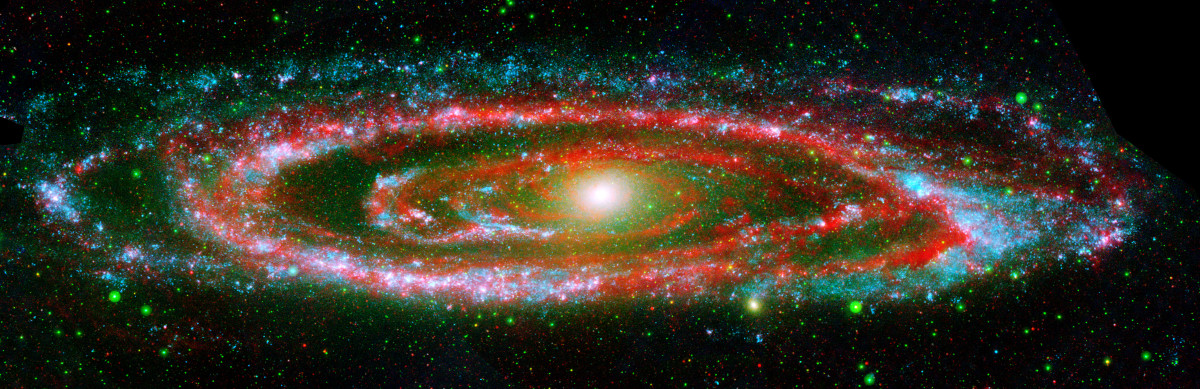 "The many ""personalities"" of our great galactic neighbor, the Andromeda galaxy, are exposed in this new composite image from NASA's Galaxy Evolution Explorer and the Spitzer Space Telescope."