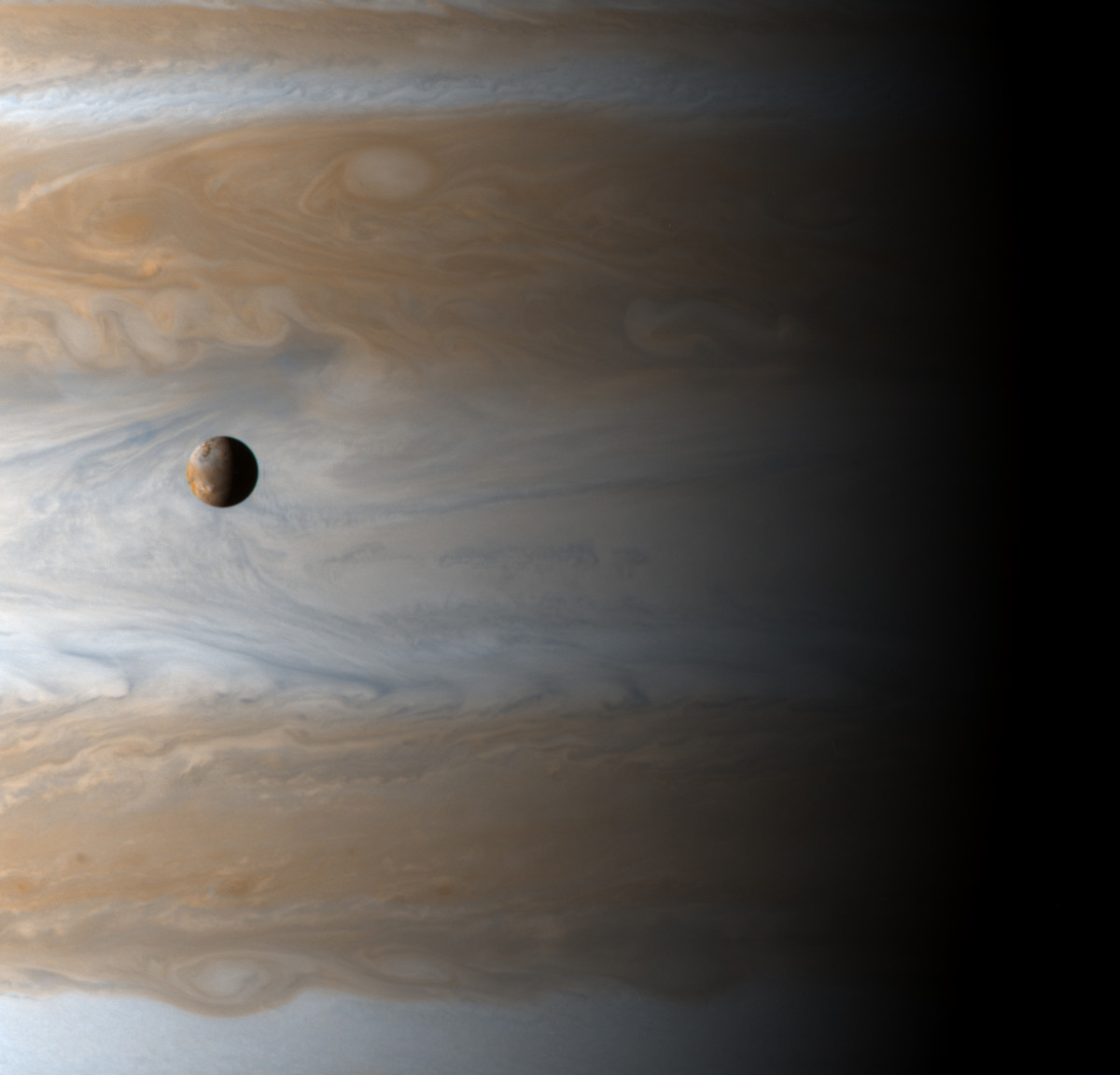 Up-close view of Jupiter and one of its moons.