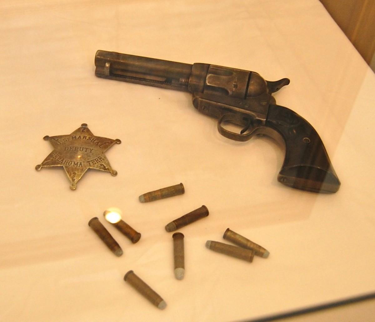 Bass Reeves gun and U.S. Marshal badge