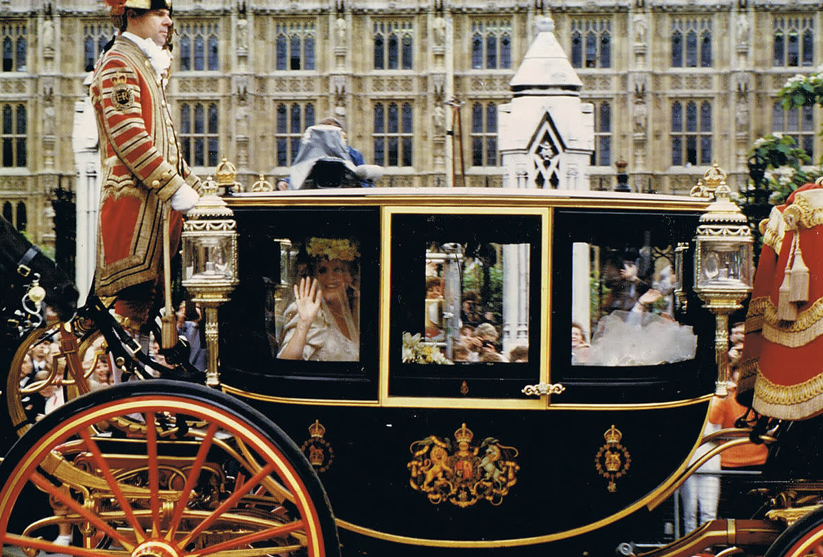 Sarah Ferguson arriving by a horse drawn royal carriage to her wedding.