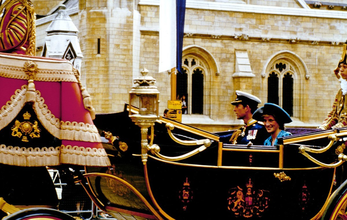 Prince Charles and Princess Diana arrive by carriage to Prince Andrews wedding