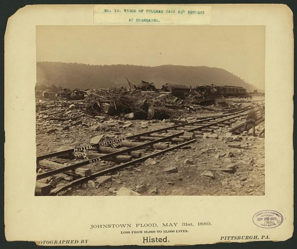Histed, Ernest Walter, 1862-1947, photographer  Railroad cars overturned by the flood of 1889