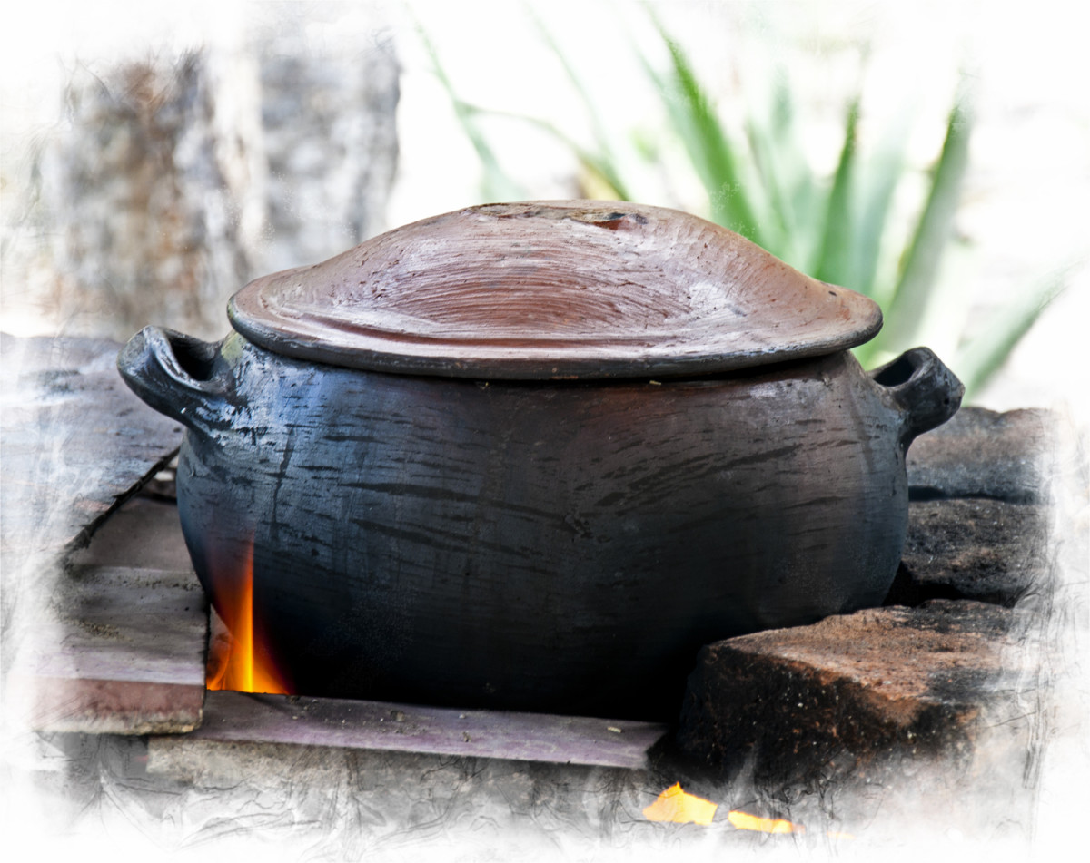 Cooking in a clay pot on a fogón.