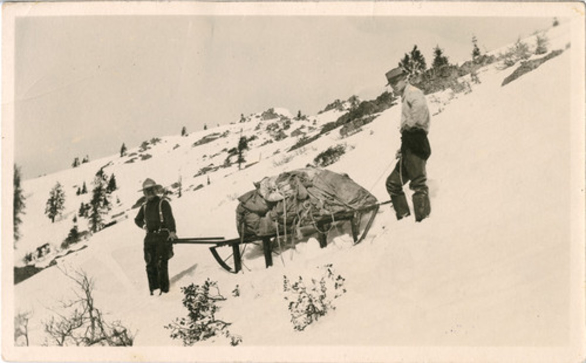 Two men haul a sled load of books in Siskiyou County, northern California on an unrecorded date.