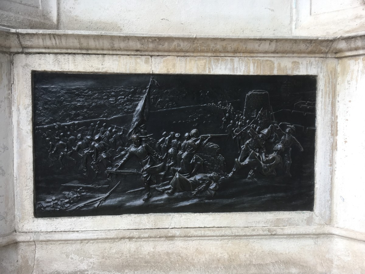 Bronze relief on the memorial showing the Boxer Rebellion - the US Marine figure is seen on the right with the distinct uniform and headgear apart from the Royal Marines