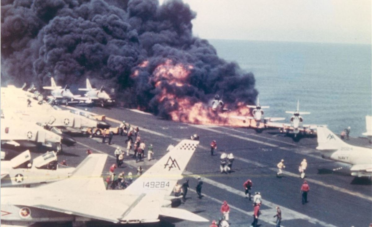 July 29, 1967 - A4s already on fire on the deck of the Forrestal, moments before the devastating explosion. McCain's A4 is third from the right, nearly engulfed.