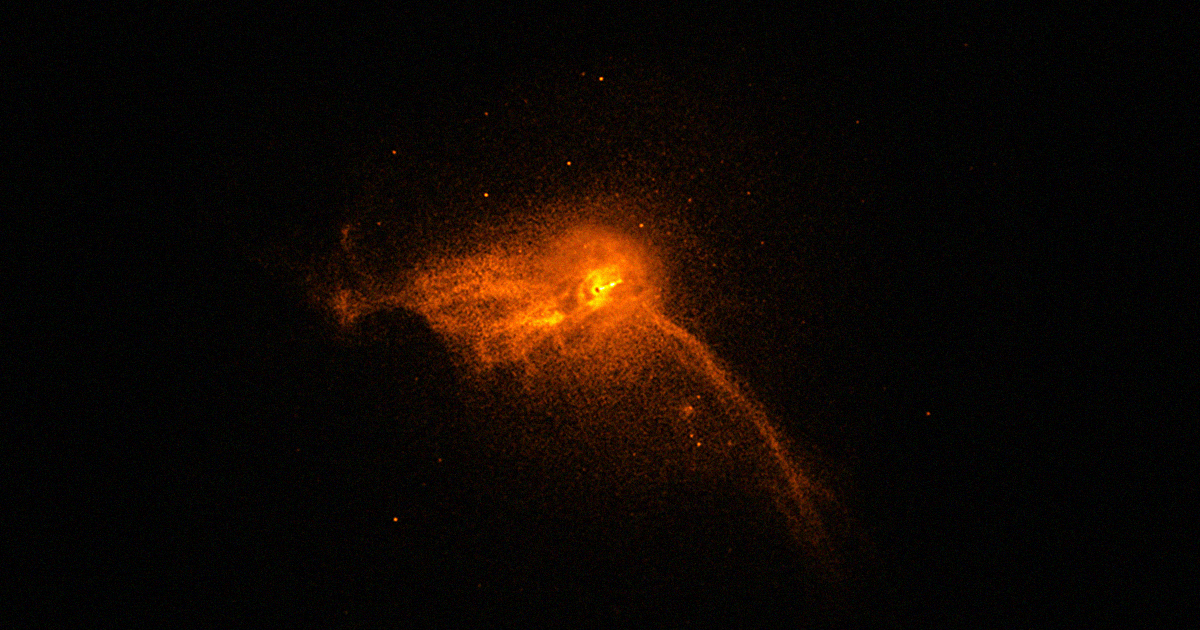 Black Hole at Messier 87, zoomed out. Notice the tiny black dot at its center.