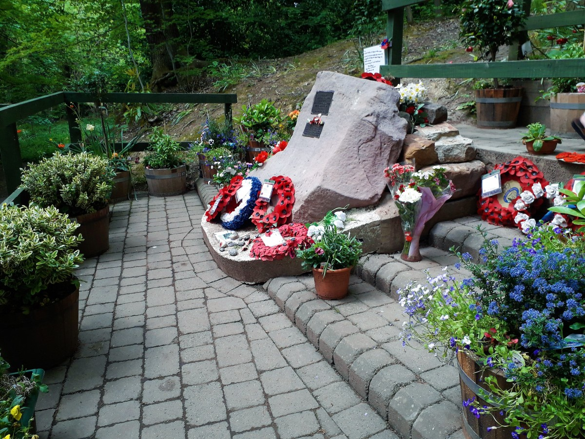 The memorial surrounded with the plants Tony has bought and tended.