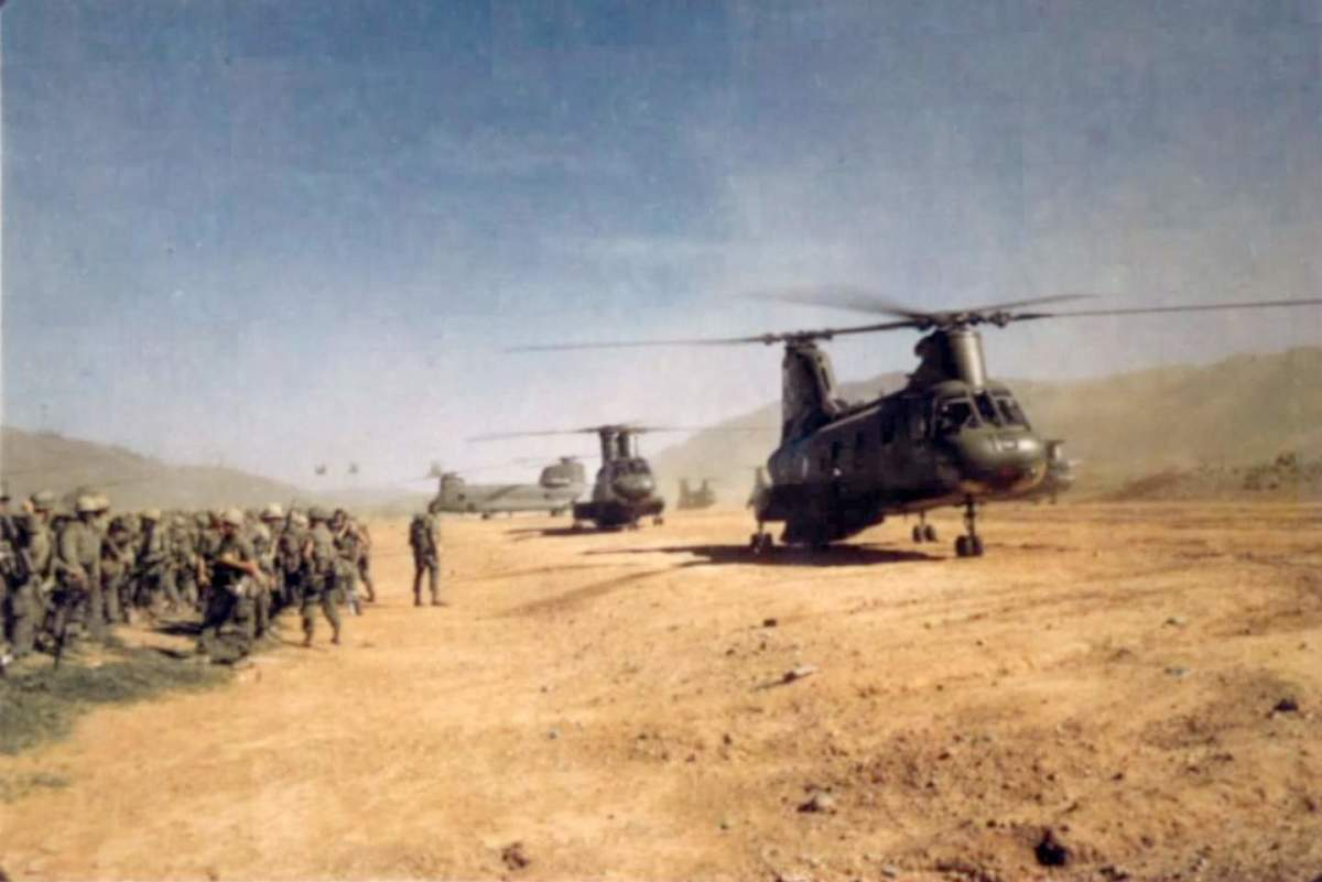 CH46s preparing to airlift Marines up to the ridge.