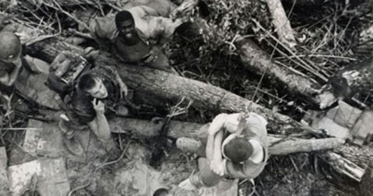 A wounded Marine gets picked up by a medevac helo. There were not a lot of landing zones on the ridge.
