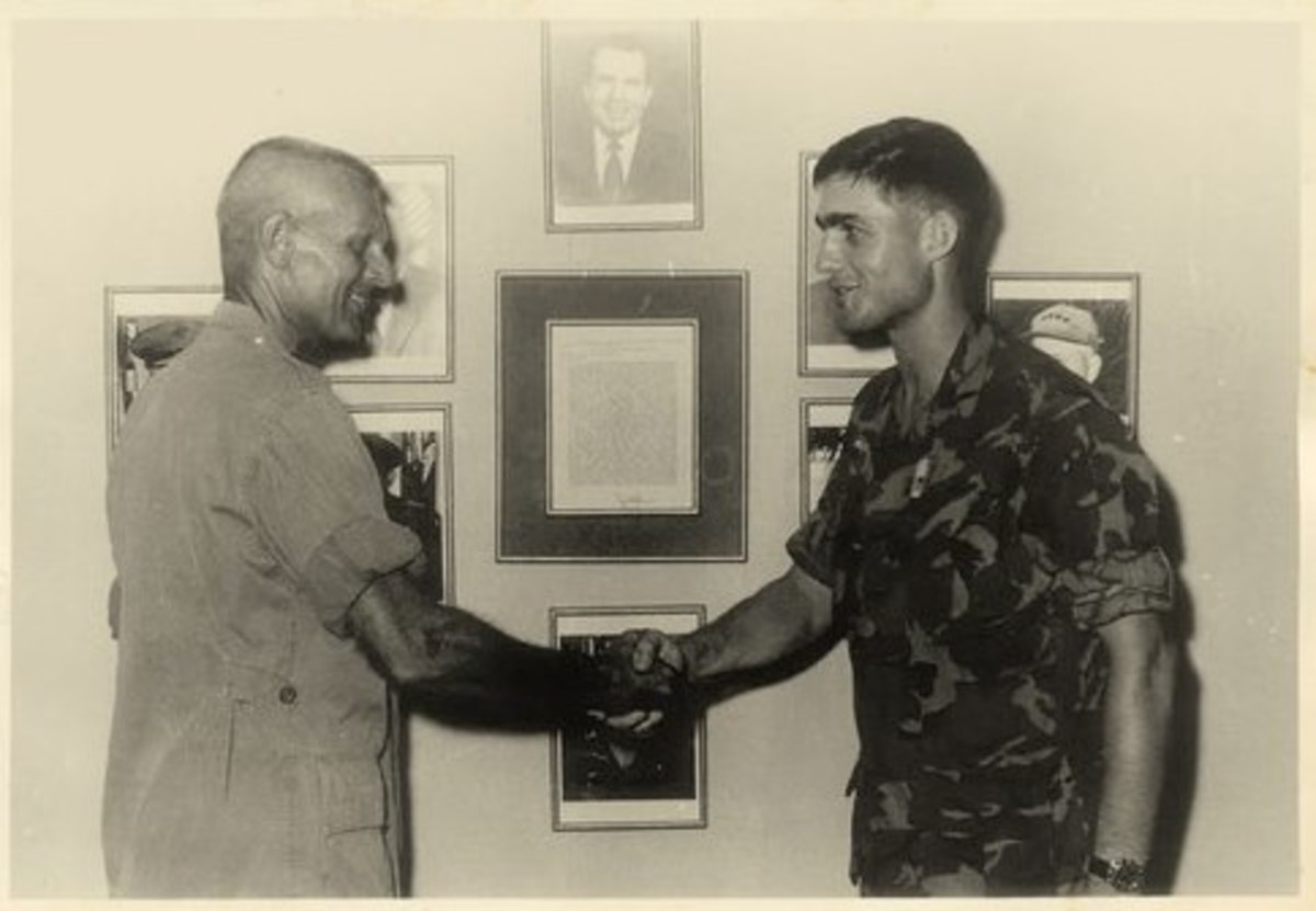 Mueller receiving his Bronze Star from 4th Marines CO, Col. Martin Sexton.