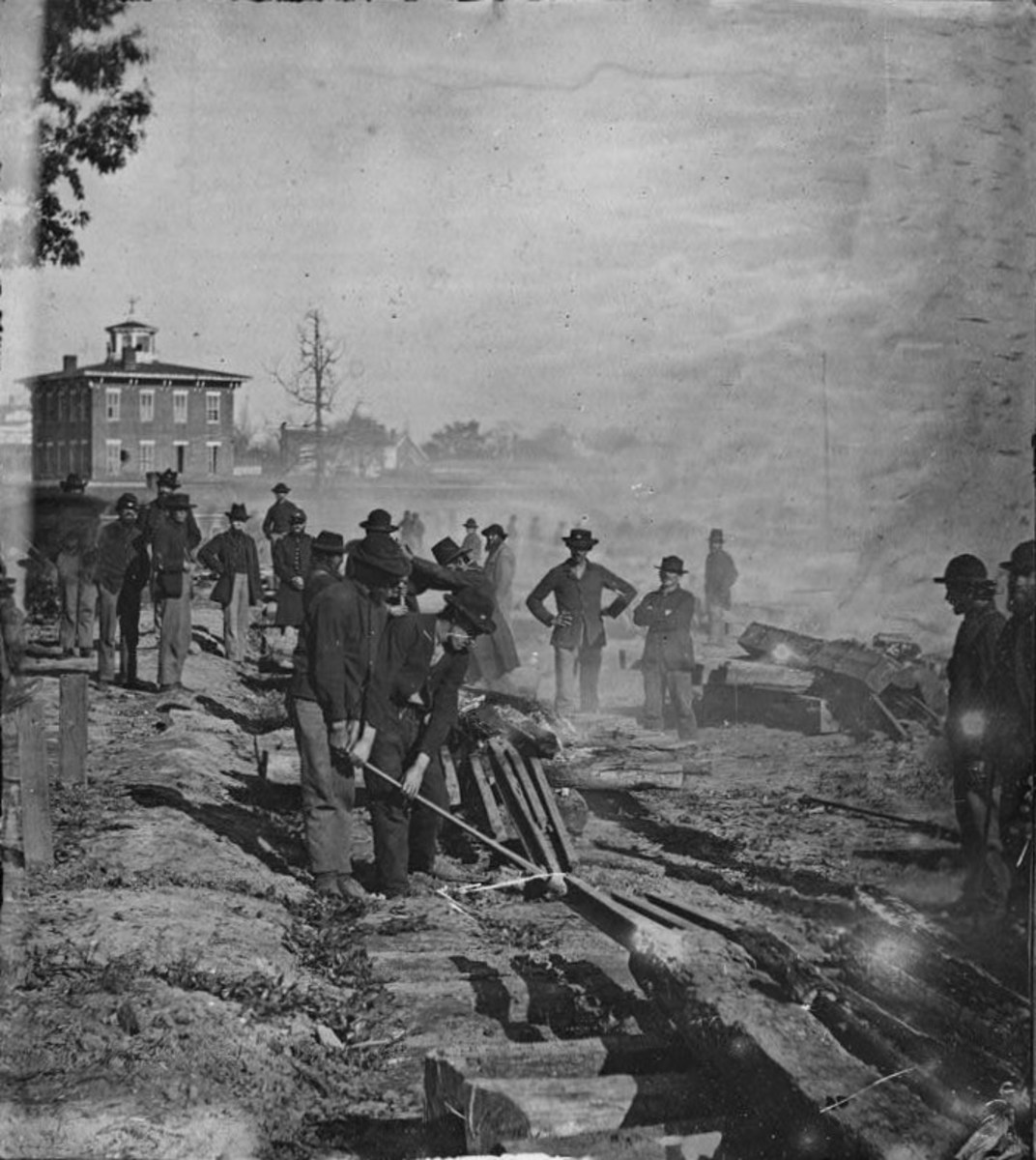 Soldiers of General Sherman destroying a railroad in Atlanta in the American Civil War