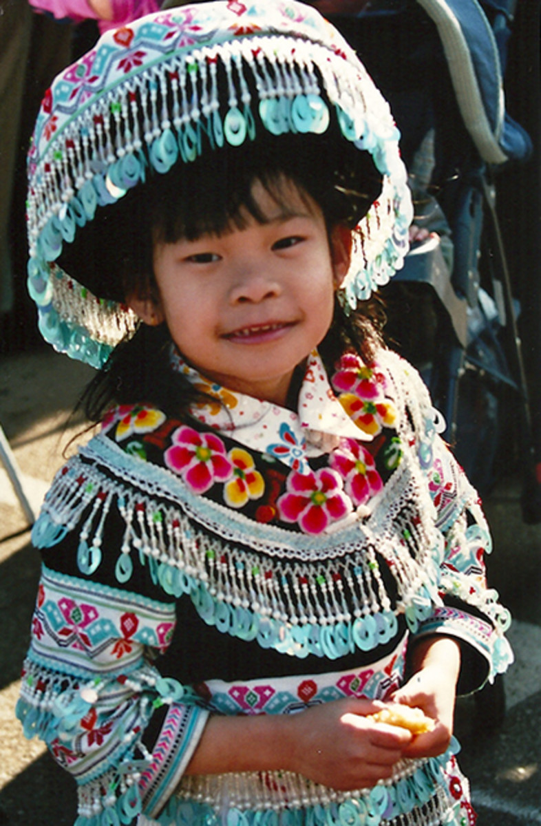 A young girl posed for me in her family's traditional dress.