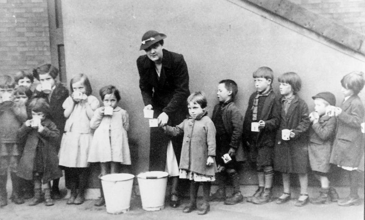 Hungry children of the strikers being fed  during the Outdoor Relief Workers' Strike.